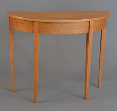 Elliptical entry table