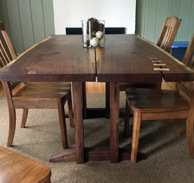 Slab dining room table with butterfly closures