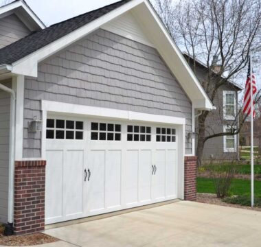 Trim and siding above garage door